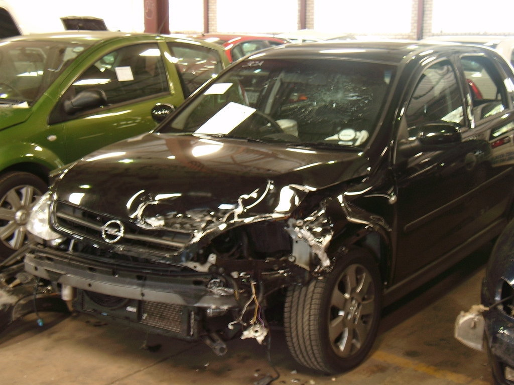 Badly damaged car being sold for cash in Perth wrecking garage